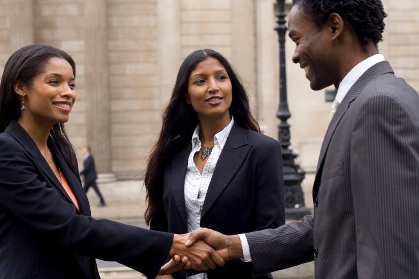 Black woman and black man shake hands