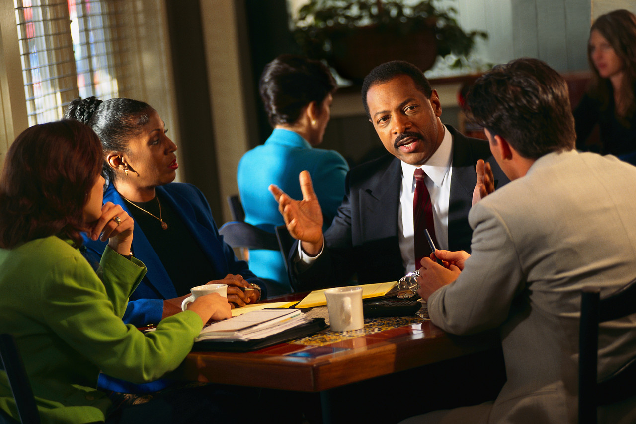 Black business people on a table