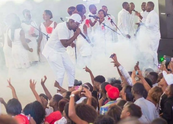 Gwamba-performing-in-Malawi-wearing-all-white