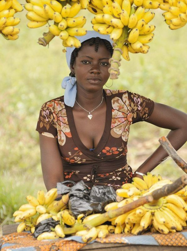 beautiful african lady selling banana at her shop