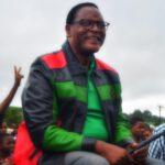 Lazarus Chakwera Wearing Mcp Leather Jacket