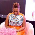 Mary Bushiri Orange With Light Blue Thing On Chest