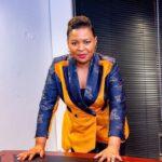 Mary Bushiri Wearing Orange Blue Outfit