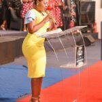 Mary Bushiri Wearing Yellow Dress With High Heels