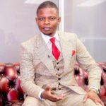 Shepherd Bushiri Brown Suit With Red Tie