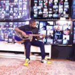Shepherd Bushiri Playing Guitar