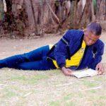 Shepherd Bushiri Reading Outside