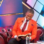 Shepherd Bushiri Smiling As He Reads Bible